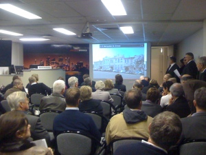 The auction room packed for the sale of Enmore School