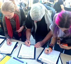 Residents sign the petition to save the markets