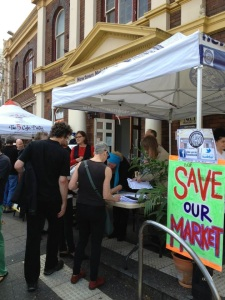Councillor Sylvie Ellsmore talks to residents signing the petition to save the markets