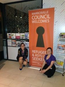 Greens Councillors Sylvie Ellsmore (L) and Melissa Brooks (R) with Refugee Welcome signs which the Greens moved to install in Council buildings, 2014
