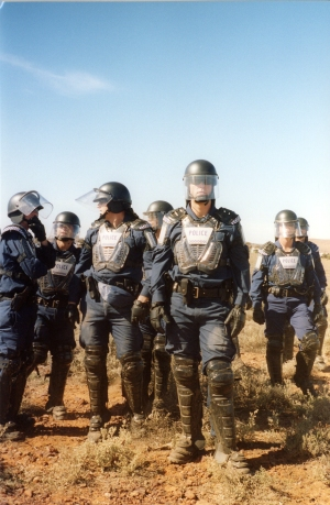 Riot police guard Baxter Detention Centre against balloon and kite wielding activists, in 2003